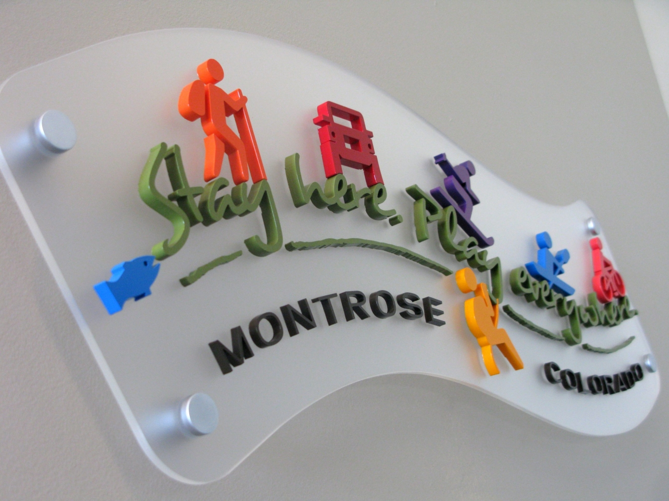 matte clear routed acrylic background, aluminum standoffs, laser cut acrylic letters with custom paint