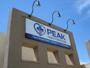 fabricated box sign with hidden hardware mounting, vinyl graphics, laser cut acrylic letters and logo